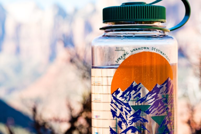 use reusable bottles of water - 15 ways to reduce carbon footprint