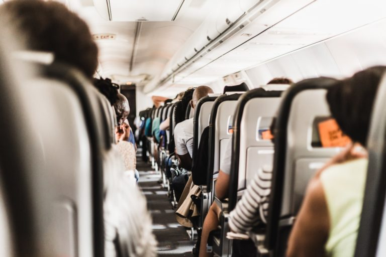 fly economy - 15 ways to reduce carbon footprint
